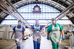 © Licensed to London News Pictures . 15/04/2020. Manchester, UK. Clinicians working on the wards of the Nightingale NW Hospital . The National Health Service has built a 648 bed field hospital for the treatment of Covid-19 patients , at the historical railway station terminus which now forms the main hall of the Manchester Central Convention Centre . The facility is due to fully open this week (ending Friday 17th April 2020 ) and will treat patients from across the North West of England , providing them with general medical care and oxygen therapy after discharge from Intensive Care Units . Photo credit : Joel Goodman/LNP