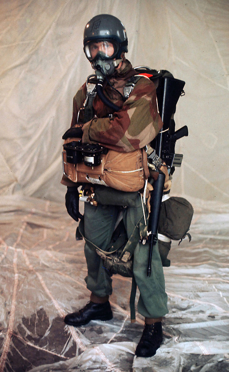 Fully equipped SAS soldier ready for a high altitude low opening(HALO) parachute drop. SAS training exercise, Brecon Beacons, Wales in 1970.Note the M16 rifle attached to his side, only the special forces had exclusive access to this weapon in the British Army. photograph by Terry Fincher