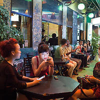 Locals hang out at the DMZ bar in Huế, Vietnam.