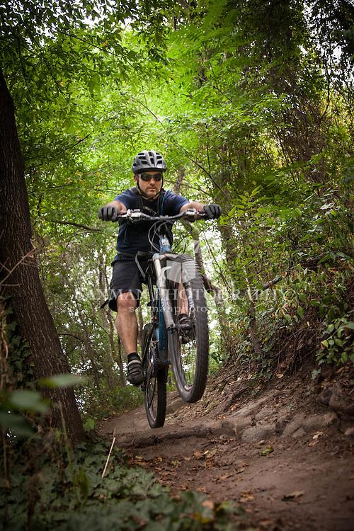 Photos of Rob Berube trail biking on Richmond's Buttermilk Trail