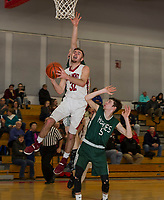 Belmont's Doug Price jumps for a shot with pressure from Monadnock's Jake Wood and Joseph Minson during NHIAA Division III Basketball Friday evening.  (Karen Bobotas/for the Laconia Daily Sun)