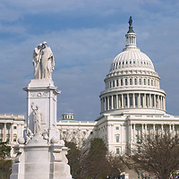 The U.S. Capitol building rises behind the Peace Monument in Washington, D.C.