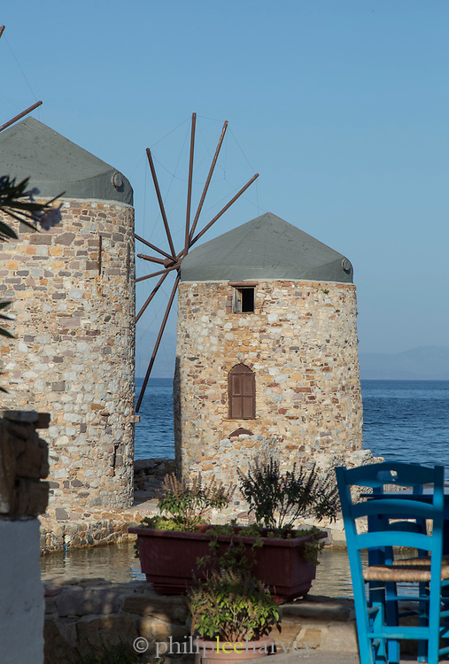 Seaside with famous historical stone windmills at Tampakika, Chios, Greece