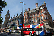 A tour bus with The Original Tour stops below Big Ben, on 7th July 2017, in Westminster, central London.