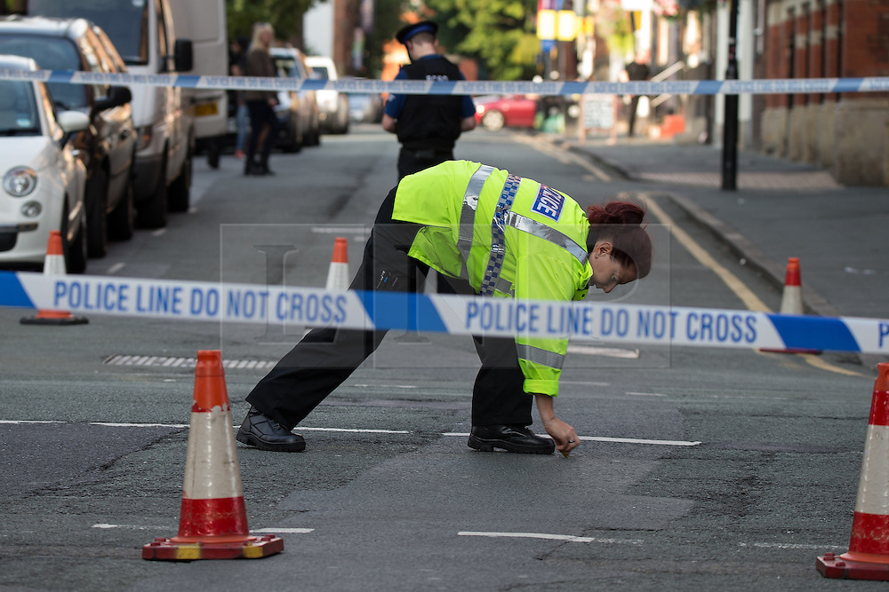 © Licensed to London News Pictures . 22/08/2015 . Manchester , UK . Police investigate the scene of a  fatal RTA on Princess Street in central Manchester . Yesterday (22nd August 2015) a 26 year old motorcyclist died after hitting a wall , after losing control of his Yamaha R6 . Photo credit : Joel Goodman/LNP