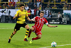 DORTMUND, Aug. 6, 2017  Bayern Munich's Thomas Mueller (R) vies with Dortmund's Marc Bartra during the 2017 German Super Cup match between Bayern Munich and Borussia Dortmund in Dortmund, Germany, on Aug. 5, 2017. Bayern Munich won 7-6 after penalty shootout and got the 2017 German Super Cup trophy. (Credit Image: © Joachim Bywaletz/Xinhua via ZUMA Wire)