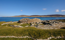 """The Broch of Gurness.  The Broch of Gurness is an Iron Age broch village on the northwest coast of Mainland Orkney in Scotland overlooking Eynhallow Sound. The remains of the central tower are up to 3.6 metres (11.8 ft) high, and the stone walls are up to 4.1 metres (13.5 ft) thick.The broch probably had a conical or mildly hyperbolic top,and has the remains of a settlement surrounding and adjoining it.<br /> <br /> Pieces of a Roman amphora dating to before 60 AD were found here, lending weight to the record that a """"King of Orkney"""" submitted to Emperor Claudius at Colchester in 43 AD.<br /> <br /> The broch is in the care of Historic Scotland.<br /> <br /> (c) Andrew Wilson 