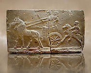Sculpted Assyrian relief panels of Royal Chariot & Guards  from Hadatu ( Aslantas ) around 800 B.C. Istanbul Archaeological museum Inv No. 1946.<br /> <br /> If you prefer to buy from our ALAMY PHOTO LIBRARY  Collection visit : https://www.alamy.com/portfolio/paul-williams-funkystock/ancient-assyria-antiquities.html  Type -    Aslantas    - into the LOWER SEARCH WITHIN GALLERY box to refine search by adding background colour, place, museum etc<br /> <br /> Visit our ANCIENT WORLD PHOTO COLLECTIONS for more photos to download or buy as wall art prints https://funkystock.photoshelter.com/gallery-collection/Ancient-World-Art-Antiquities-Historic-Sites-Pictures-Images-of/C00006u26yqSkDOM
