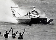 Bill Muncey takes a victory lap during powerboat racing at Miami Marine Stadium on Virginia Key in Miami, Florida in 1979.
