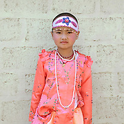 Shinbyu Novice Ceremony on 20th March 2016 in Ti Chit village, Shan State, Myanmar. In Myanmar, it is customary for boys to enter the monastery as a Buddhist novice between the age of ten and 20 years old although they can be as young as four, for at least one week. During the ceremony, which lasts two or sometimes three days, the boys are dressed and made-up to be a prince and paraded through the village before being ordained as novice monks.