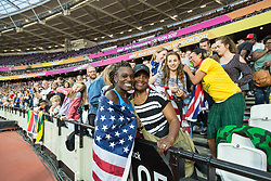 London, August 12 2017 . Dawn Harper Nelson, USA, is embraced by her proud mother Linda following her silver medal in the women's 100m hurdles final on day nine of the IAAF London 2017 world Championships at the London Stadium. © Paul Davey.