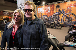 Jelena Billo and Fred Kodlin in their Murder Cycles booth in the custom themed Hall 10 at the Intermot Motorcycle Trade Fair. Cologne, Germany. Wednesday October 5, 2016. Photography ©2016 Michael Lichter.Intermot Motorcycle Trade Fair. Cologne, Germany. Wednesday October 5, 2016. Photography ©2016 Michael Lichter.
