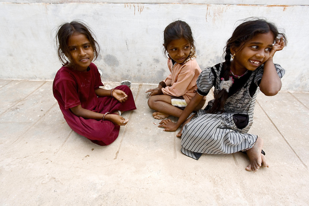 Girls play on the street of their village in Tamil Nadu, India.