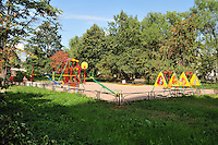 A brightly painted playground at the housing blocks directly opposite the Salt Pier, where river boats moor in St. Petersburg, Russia.