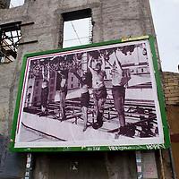 L'immagine di piazzale Loreto  affissa al Quartiere San Lorenzo