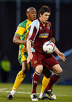 Photo: Paul Greenwood.<br />Burnley v Norwich City. Coca Cola Championship. 17/04/2007.<br />Burnley's Wade Elliott (R) shields the ball from Dion Dublin