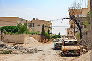 General picture shows Anadan, along with the rest of what resembles a ghost town on Monday, June 25, 2012. It bears the scars from Syrian President Bashar al-Assad's use of military force to crush an opposition movement that has spawned an armed insurgency against his rule. (Photo by Vudi Xhymshiti)