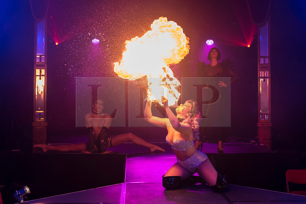 """© Licensed to London News Pictures. 24/04/2019. LONDON, UK. Kitty Bang Bang (fire breathing bearded lady) performs at the preview of Bernie Dieter's """"Little Death Club"""" an eclectic performance show taking place at the Underbelly Festival on the Southbank until 23 June 2019.  Photo credit: Stephen Chung/LNP"""