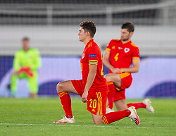 HELSINKI, FINLAND - Thursday, September 3, 2020: Wales' Daniel James kneels down (takes a knee) in support of the Black Lives Matter movement before the UEFA Nations League Group Stage League B Group 4 match between Finland and Wales at the Helsingin Olympiastadion. (Pic by Jussi Eskola/Propaganda)