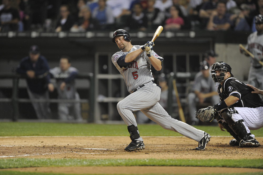 CHICAGO - SEPTEMBER 23:  Michael Cuddyer #5 of the Minnesota Twins bats against the Chicago White Sox on September 23, 2009 at U.S. Cellular Field in Chicago, Illinois.  The Twins defeated the White Sox 8-6.  (Photo by Ron Vesely)