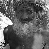 A day-laborer rests between carrying baskets of mud from a canal that he is digging to mitigate monsoon flooding with a crew of other villagers of Manikganj, Bangladesh. 1977