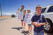 04 AUGUST 2010 -- GILBERT, AZ: L to R background to foreground: Holli Pearce (CQ Holli), her daughter Emalyn Pearce (CQ) 8, and son Nathen Pearce (CQ NATHEN) from Mesa, put their hands over their hearts as the Det. Carlos Ledesma's cortege passes at the funeral for Chandler police detective Carlos Ledesma Wednesday. Kenzlie is the daughter of fallen Phoenix Police Officer Shane Figueroa. Ledesma was killed during a shoot out with suspected drug dealers during an undercover operation in south Phoenix Wednesday July 28.   PHOTO BY JACK KURTZ