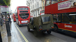 © Licensed to London News Pictures. 18/07/2012. Westminster, UK An army land rover on Whitehall. Soldiers, police and security contractors perform security checks around Olympic sites in Westminster today, 18th July 2012. Photo credit : Stephen Simpson/LNP