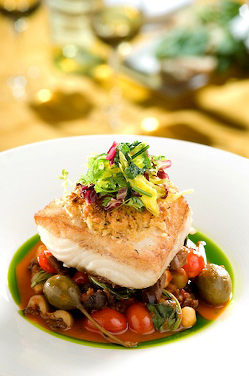 Chilean Sea Bass with caper berries, cherry tomatoes and chick peas.