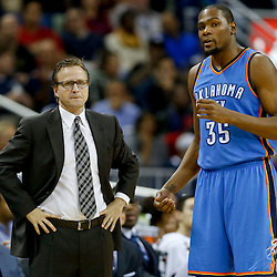 Dec 2, 2014; New Orleans, LA, USA; Oklahoma City Thunder head coach Scott Brooks talks with forward Kevin Durant (35) against the New Orleans Pelicans during a game at the Smoothie King Center. The Pelicans defeated the Thunder 112-104. Mandatory Credit: Derick E. Hingle-USA TODAY Sports