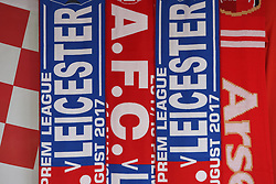 Arsenal and Leicester City flags outside the stadium