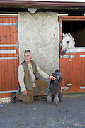 09/08/2012 Repro free first use. Michael Regan with his dog Gorm at the Connemara Pony Show in Clifden County Galway . Photo:Andrew Downes.