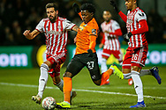 Barnet midfielder Ephron Mason-Clark (27) goes past Brentford defender Yoann Barbet (29) to shoots towards the goal during the The FA Cup fourth round match between Barnet and Brentford at The Hive Stadium, London, England on 28 January 2019.