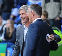 Blackpool manager José Riga and Reading manager Nigel Adkins are all smiles before kick-off<br /> <br /> Photographer Kevin Barnes/CameraSport<br /> <br /> Football - The Football League Sky Bet Championship - Reading v Blackpool - Saturday 25th October 2014 - Madejski Stadium - Reading <br /> <br /> © CameraSport - 43 Linden Ave. Countesthorpe. Leicester. England. LE8 5PG - Tel: +44 (0) 116 277 4147 - admin@camerasport.com - www.camerasport.com
