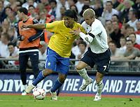 Photo: Richard Lane.<br />England v Brazil. International Friendly. 01/06/2007. <br />Brazil's Ronaldinho is challenged by England's David Beckham.