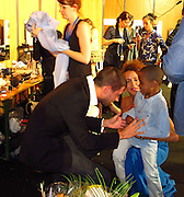 Noémie Lenoir with her son Kelyan..Fashion For Relief Japan Fundraiser Hosted by Naomi Campbell..2011 Cannes Film Festival..Cannes Center..Cannes, France..Monday, May 16, 2011..Photo By CelebrityVibe.com..To license this image please call (212) 410 5354; or.Email: CelebrityVibe@gmail.com ;.website: www.CelebrityVibe.com.**EXCLUSIVE**