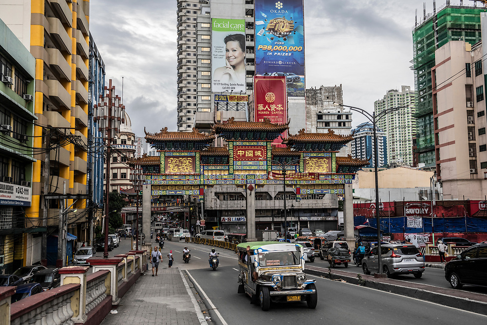 Traffic passes under the new (2015) Chinatown arch in Manila, Philippines (July 27, 2019)