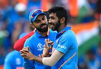 Cricket - 2019 ICC Cricket World Cup - Group Stage: Bangladesh vs. India<br /> <br /> India's Jasprit Bumrah congratulated by India's Virat Kohli after dismissing Bangladesh's Mosaddek Hossain for 3, at Edgbaston<br /> <br /> COLORSPORT/ASHLEY WESTERN