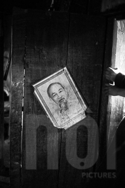 Crooked picture of Uncle Ho on the door of a home in a Hmong Village, Ha Giang Province, Northern Vietnam, Southeast Asia