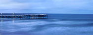 A Fishing Pier Boldly Reaching Into The Vastness Of The Blue Pacific Ocean In Pre Dawn Light Near San Diego California, USA