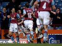 Photo: Glyn Thomas.<br />Aston Villa v Manchester City. The FA Cup. 19/02/2006.<br /> Villa's Milan Baros (L) is mobbed by teammates after scoring his team's opening goal.