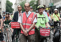 © Licensed to London News Pictures. 16/07/2013. London, UK. A mass demonstration of cyclists protesting about the danger of London's roads to cyclists cycle past where a male cyclist was killed by a tipper lorry a day earlier.  The demonstration was organised by the London Cycling Campaign . Photo credit : Richard Isaac/LNP