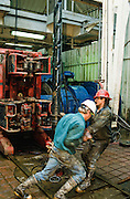 Alaska. Workers on an oil rig offshore.