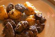 Domaine Piccinini in La Liviniere Minervois. Languedoc. Freginate de sanglier, a local typical stew made from wild boar. With potatoes. France. Europe.