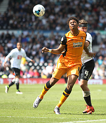 Chuba Akpom of Hull City (L) and Craig Bryson of Derby County in action - Mandatory by-line: Jack Phillips/JMP - 14/05/2016 - FOOTBALL - iPro Stadium - Derby, England - Derby County v Hull City - Sky Bet Championship Play-Off Semi-Final First-Leg