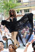 """De Canal Parade 2014 - een botenparade over de Amsterdamse grachten en het hoogtepunt van Gay Pride Amsterdam.<br /> <br /> The Canal Parade 2014 - a boat parade on the canals of Amsterdam and the highlight of Gay Pride Amsterdam.<br /> <br /> Op de foto / On the photo: <br /> <br /> <br />  Dana International - Sharon Cohen op de  """"Joodse"""" Boot / Dana International - Sharon Cohen on the """"Jewish"""" boat."""