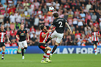 Football - 2019 / 2020 Premier League - Southampton vs. Manchester United<br /> <br /> Victor Lindelof of Manchester United grabs a handful of Southampton's Shane Long shirt whilst winning a header during the Premier League match at St Mary's Stadium Southampton <br /> <br /> COLORSPORT/SHAUN BOGGUST