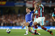Branislav Ivanovic of Chelsea (l) intercepts Dimitri Payet of West Ham United. Premier league match, Chelsea v West Ham United at Stamford Bridge in London on Monday 15th August 2016.<br /> pic by John Patrick Fletcher, Andrew Orchard sports photography.