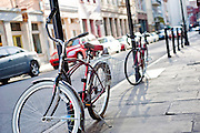 A bike rests against a pole on a street in New Orleans, Louisiana.