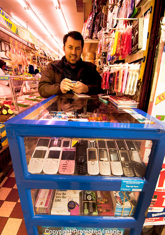 Hole in the wall shop selling cheap mobile phones an products