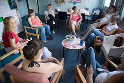 Young women and teacher in a parenting class; run by the Aspire Training Scheme for young mothers and mothers to be,